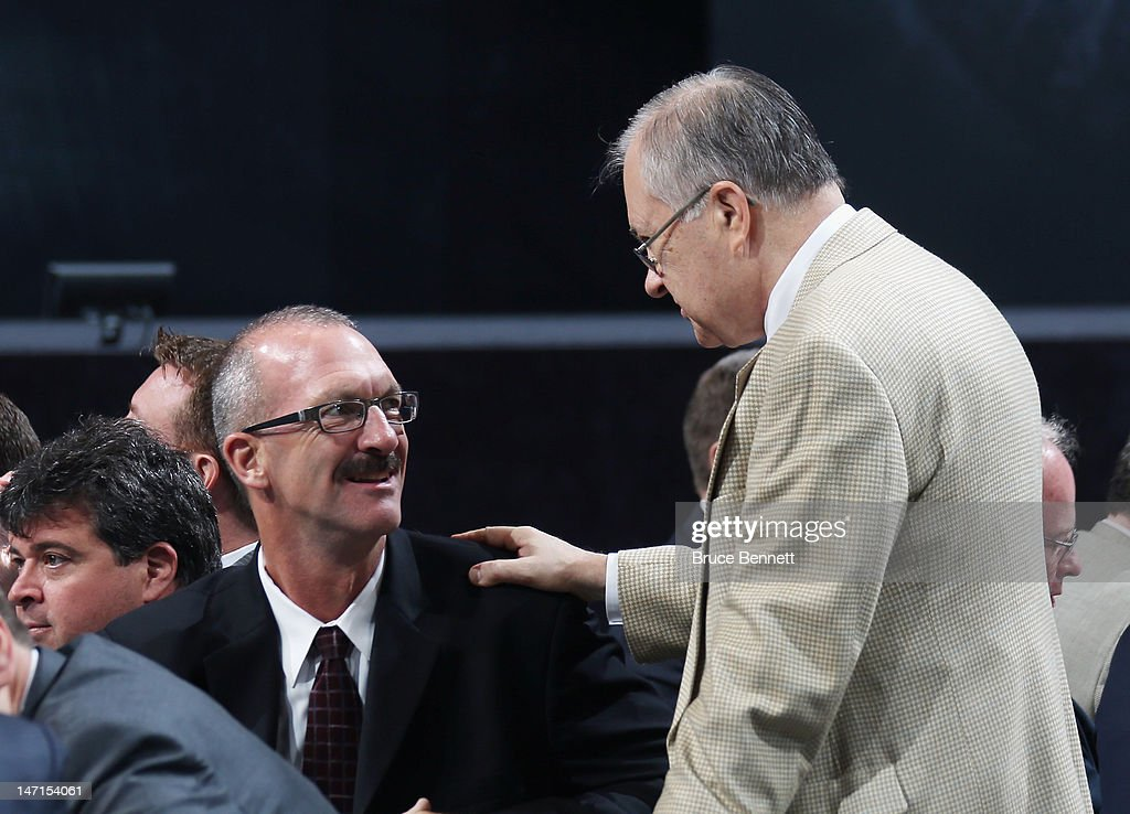 Ken Morrow of the New York Islanders and Jim Devallano of the Detroit Red Wings discuss matters during day two of the 2012 NHL Entry Draft at Consol Energy Center on June 23, 2012 in Pittsburgh, Pennsylvania.
