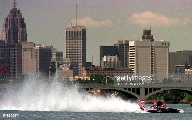 Ken Muscatel pilots the U14 Miss Bell Forklift/Toyota Industrial Equipment hydroplane on the Detroit River with the Detroit Michigan skyline in the...