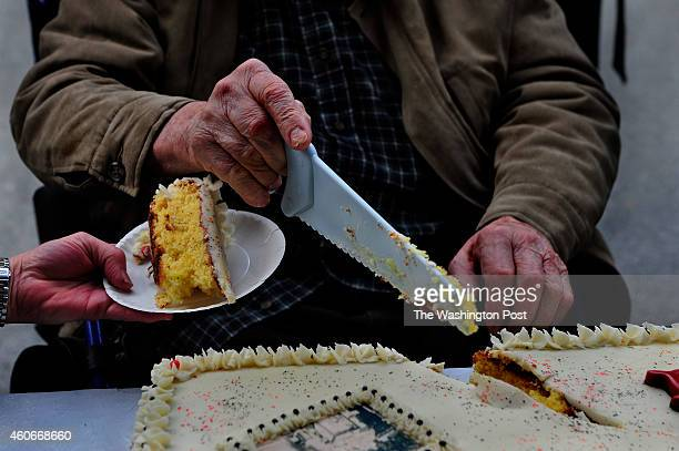 Ken Nichols was asked to cut the first piece of cake that was made to honor the 100th anniversary of his store Nichols used a plastic saw to cut the...