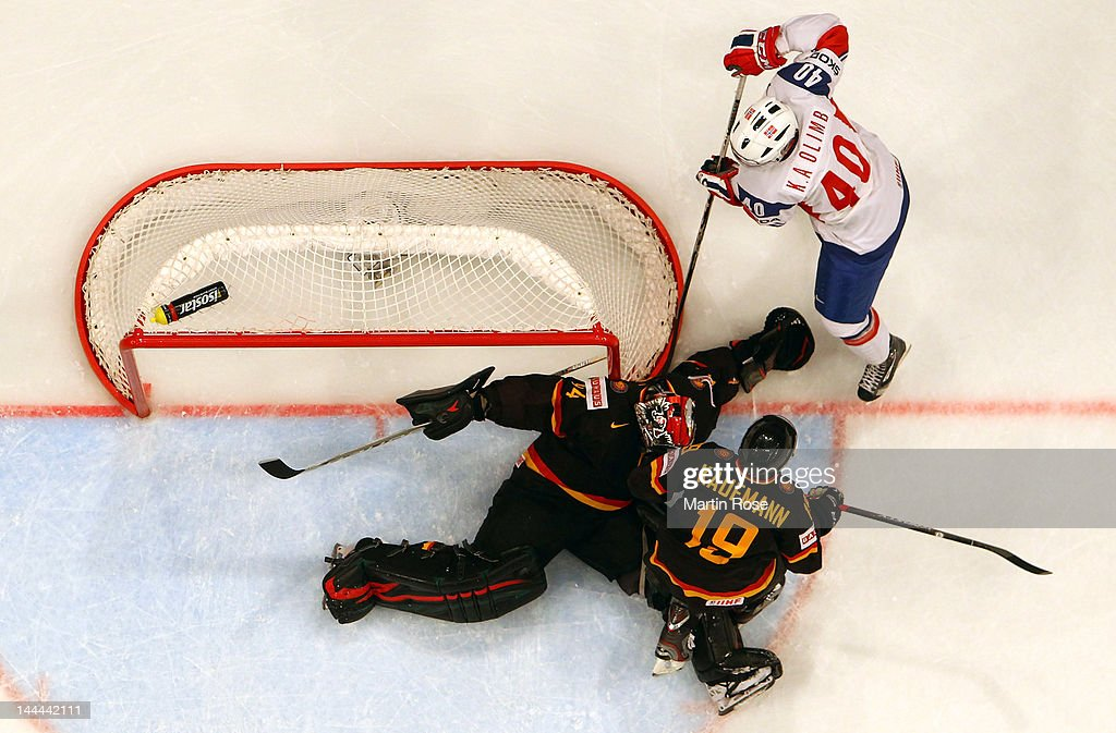 Ken Olimb (#40) of Norway fails to score over Dennis Endras (C), goaltendet of Germany during the IIHF World Championship group S match between Germany and Norway at Ericsson Globe on May 13, 2012 in Stockholm, Sweden.