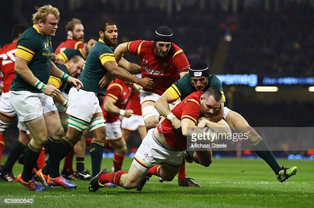 Ken Owens of Wales dives to score his team's first try during the international match between Wales and South Africa at Principality Stadium on...