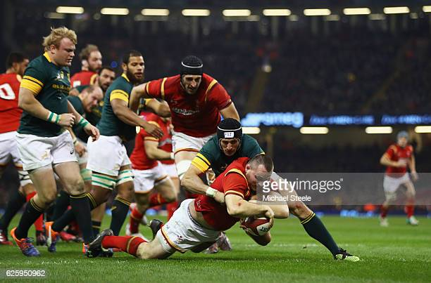 Ken Owens of Wales grounds the ball to score his team's first try during the international match between Wales and South Africa at Principality...