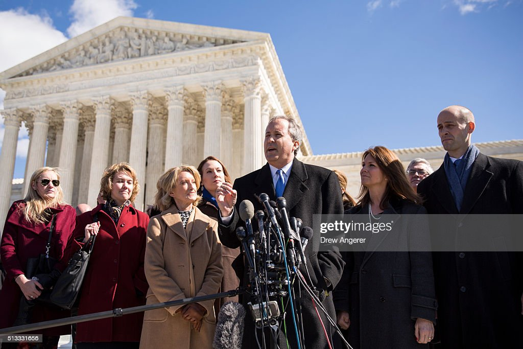 Ken Paxton (3rd R), Attorney General for the state of Texas, and Scott Keller (R), Solicitor General for the state of Texas, speak to the media at the Supreme Court, March 2, 2016 in Washington, DC. On Wednesday morning, the Supreme Court will hear oral arguments in the Whole Woman's Health v. Hellerstedt case, where the justices will consider a Texas law requiring that clinic doctors have admitting privileges at local hospitals and that clinics upgrade their facilities to standards similar to hospitals.