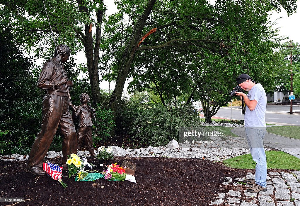 Ken Peery of Lynchburg, Virginia, photographs the flowers left next to a statue outside of the Andy Griffith Museum in remembrance of actor Andy Griffith on July 3, 2012 in Mt Airy, North Carolina. Griffith died around 7am at his North Carolina home at age 86.