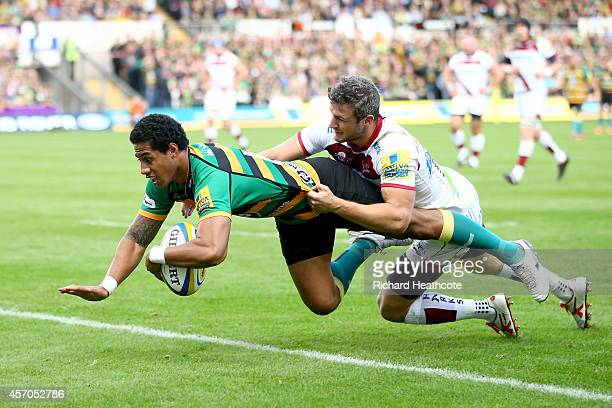 Ken Pisi dives throught to score the opening try for Saints during the Aviva Premiership match between Northampton Saints and Sale Sharks at...