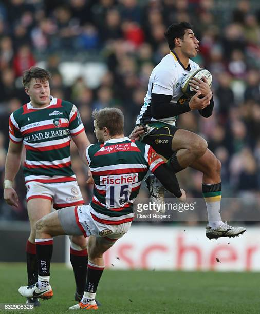Ken Pisi of Northampton beats Mathew Tait to the high ball during the AngloWelsh Cup match between Leicester Tigers and Northampton Saints at Welford...