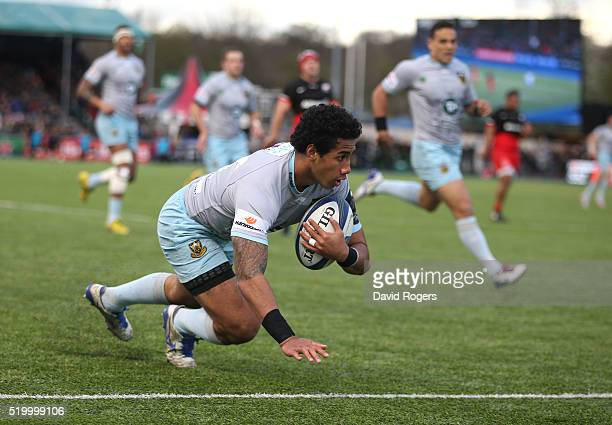 Ken Pisi of Northampton dives to score the first try duirng the European Rugby Champions Cup quarter final match between Saracens and Northampton...