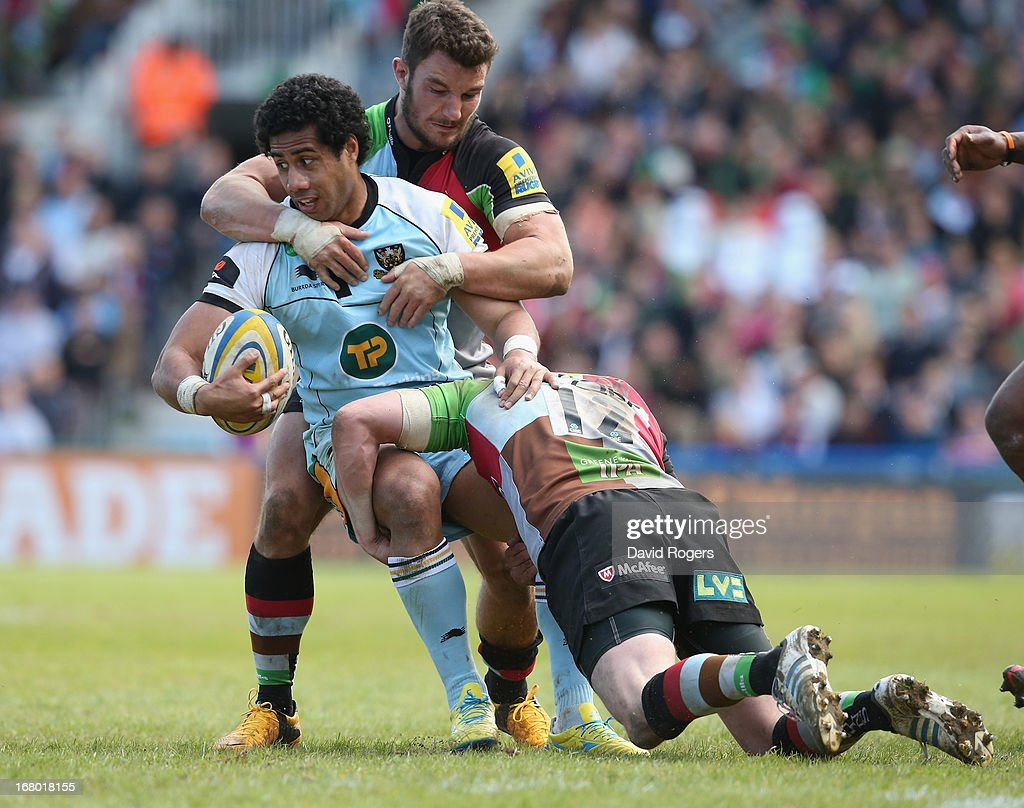 Ken Pisi of Northampton is tackled by George Lowe and Tom Casson during the Aviva Premiership match between Harlequins and Northampton Saints at Twickenham Stoop on May 4, 2013 in London, England.