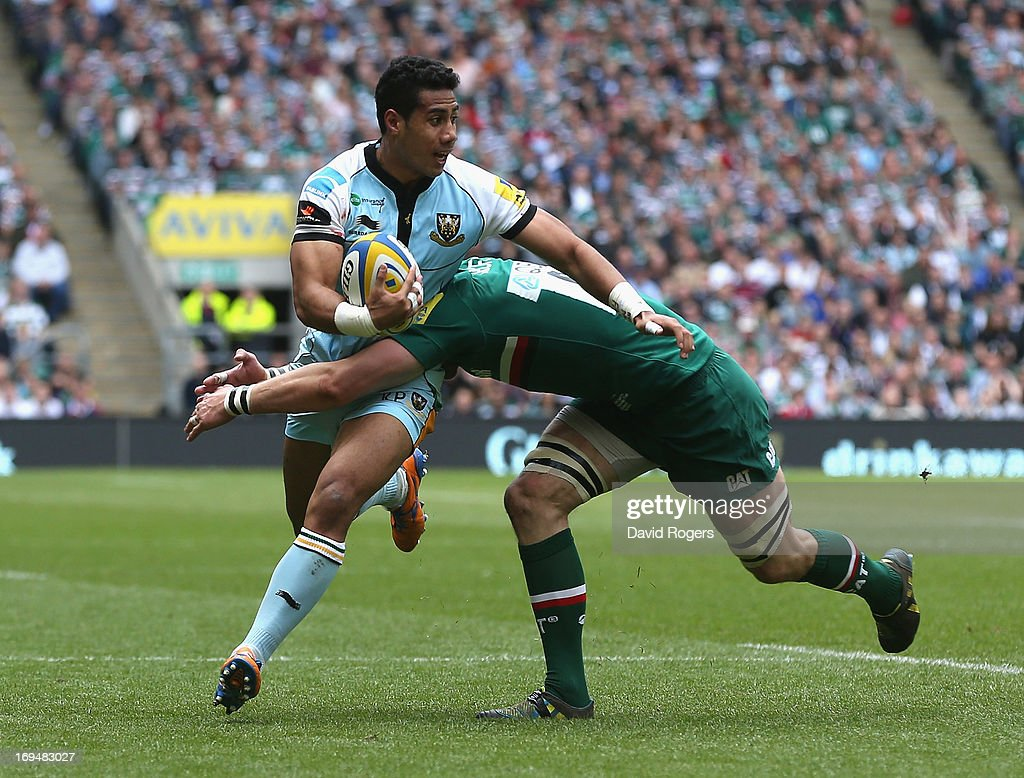 Ken Pisi of Northampton is tackled by Tom Croft during the Aviva Premiership Final between Leicester Tigers and Northampton Saints at Twickenham Stadium on May 25, 2013 in London, England.