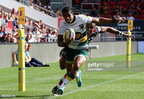 Ken Pisi of Northampton narrowly avoids stepping into touch as he rounds Tom Varndell to score their third try during the Aviva Premiership match...