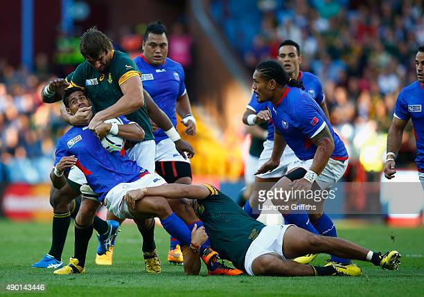 Ken Pisi of Samoa is tackled by Eben Etzebeth of South Africa during the 2015 Rugby World Cup Pool B match between South Africa and Samoa at Villa...