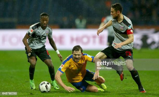 Ken Reichel of Braunschweig and Christian Gentner of Stuttgart battle for the ball during the Second Bundesliga match between Eintracht Braunschweig...