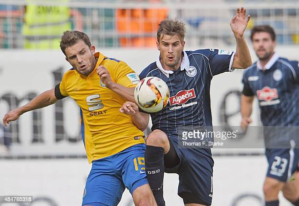 Ken Reichel of Braunschweig and Christopher Noethe of Bielefeld fight for the ball during the Second Bundesliga match between Arminia Bielefeld and...