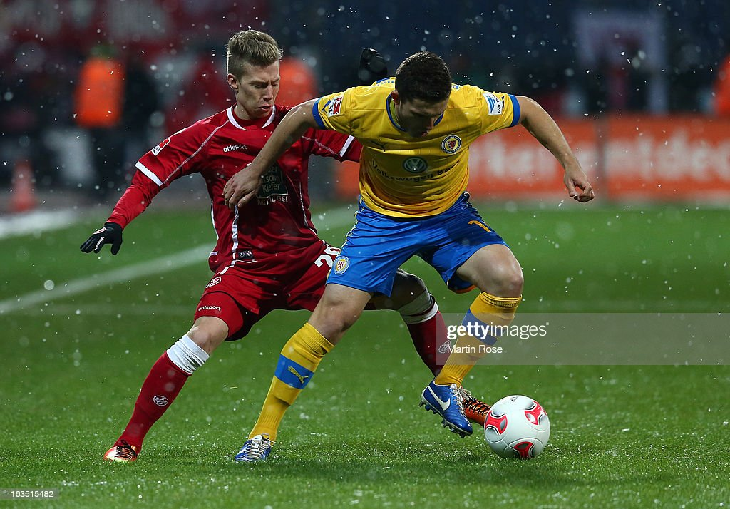 Ken Reichel (R) of Braunschweig and Mitchell Weiser ((div)) of Kaiserslautern battle for the ball during the second Bundesliga match between Eintracht Braunschweig and 1. FC Kaiserslautern at Eintracht Stadium on March 11, 2013 in Braunschweig, Germany.