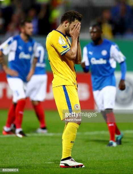 Ken Reichel of Braunschweig reacts after he fails to score the opening goal by penalty kick during the DFB Cup first round match between Holstein...