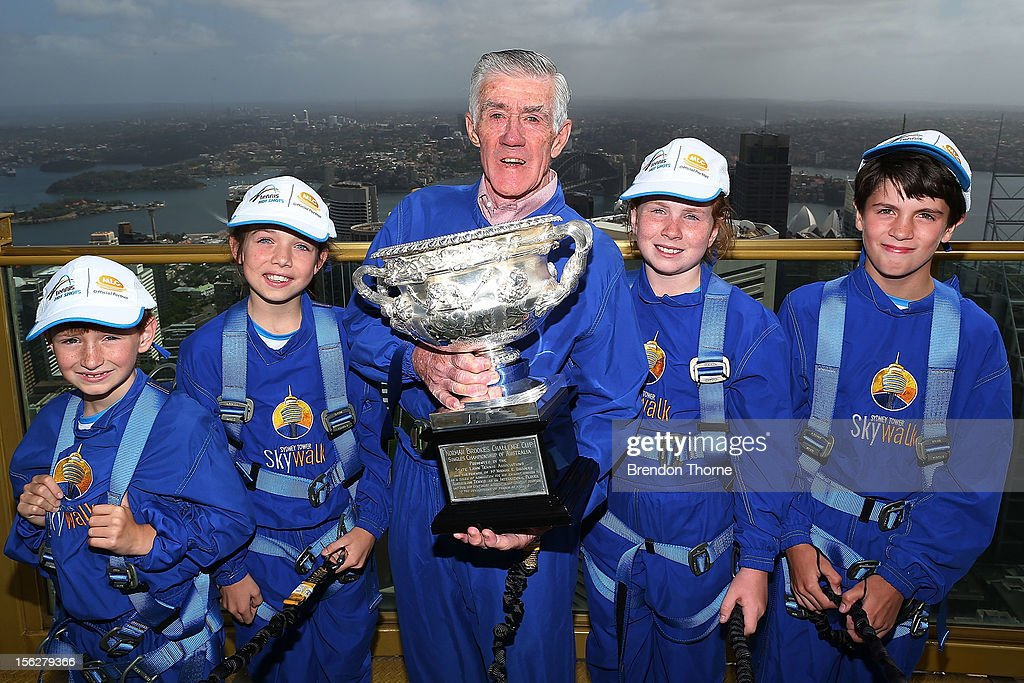 Ken Rosewall and young tennis players pose with the Australian Open Men's singles trophy during the Australian Open Trophy Tour at Sky Walk, Sydney Tower on November 13, 2012 in Sydney, Australia.