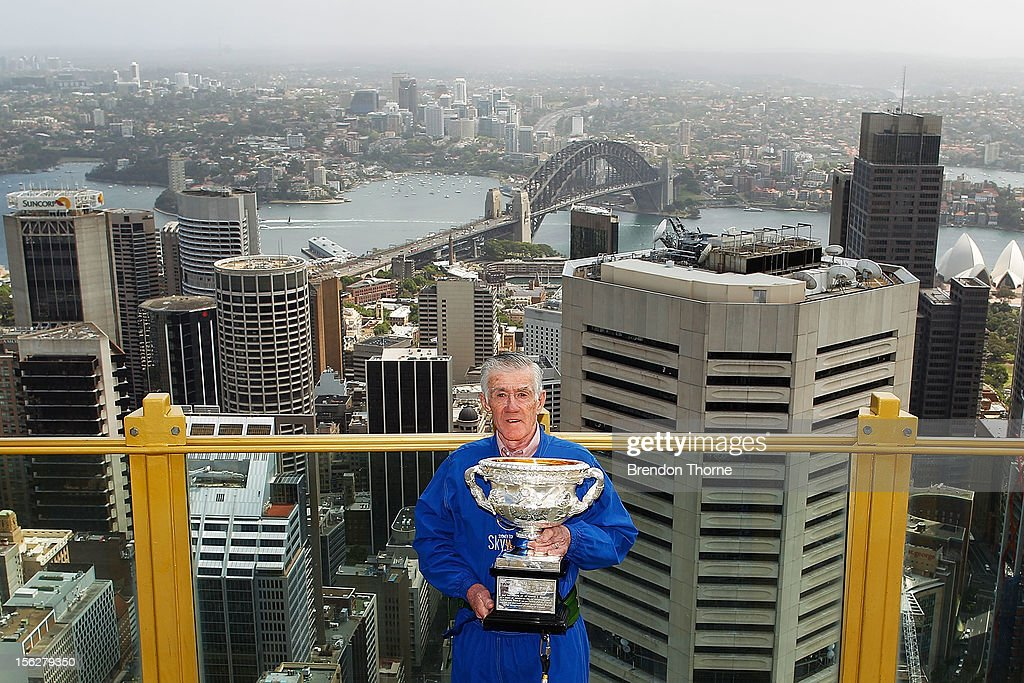 <a gi-track='captionPersonalityLinkClicked' href=/galleries/search?phrase=Ken+Rosewall&family=editorial&specificpeople=208136 ng-click='$event.stopPropagation()'>Ken Rosewall</a> poses with the Australian Open Men's singles trophy during the Australian Open Trophy Tour at Sky Walk, Sydney Tower on November 13, 2012 in Sydney, Australia.