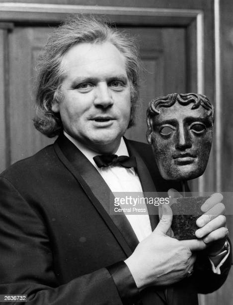 Ken Russell film director holds a BAFTA trophy for the Desmond Davis Award for the most creative contribution to television producing at the...
