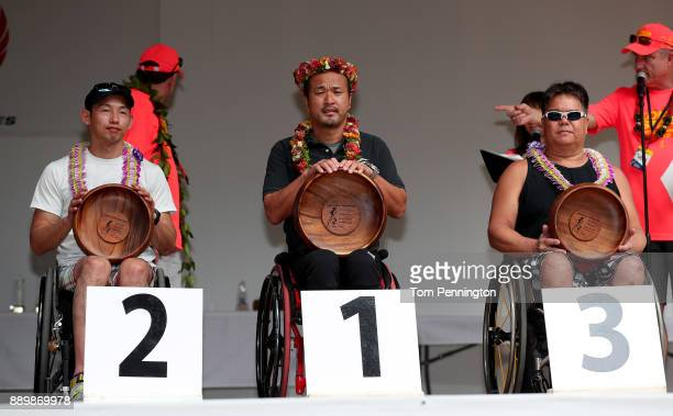 Ken Sato in second place Masazumi Soejima in first place and John Greer in third place during the awards ceremony for the Men's Wheel Chair Division...