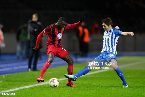 Ken Sema of Ostersunds FK and Genki Haraguchi of Hertha Berlin SC competes for the ball during the UEFA Europa League group J match between Hertha...