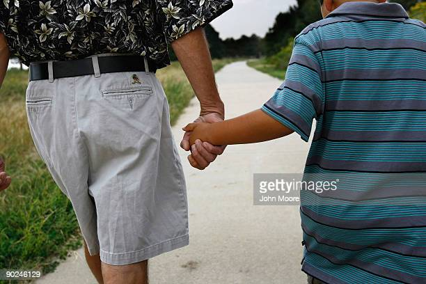 Ken Sheel terminally ill with pancreatic cancer walks with his son Jonathan during a home hospice visit on August 31 2009 in Denver Colorado The...