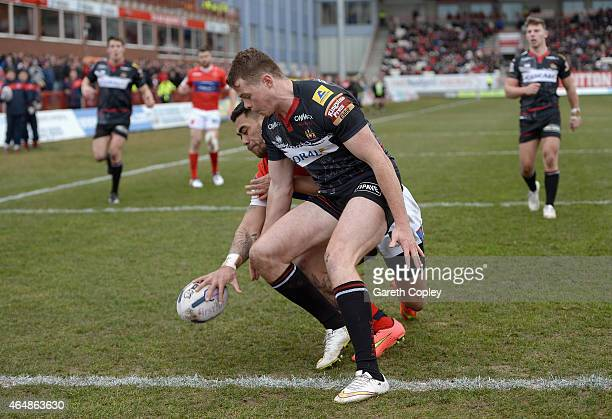 Ken Sio of Hull Kingston Rovers scores the opening try past Joe Burgess of Wigan Warriors during the First Utility Super League match between Hull KR...