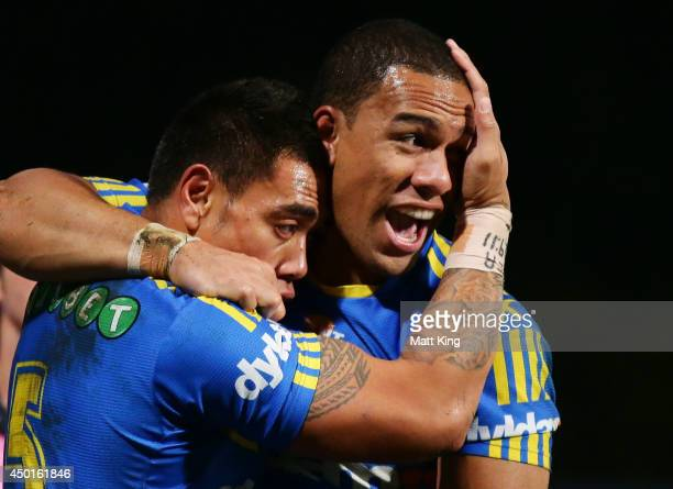 Ken Sio of the Eels celebrates with Will Hopoate after scoring a try during the round 13 NRL match between the Parramatta Eels and the North...