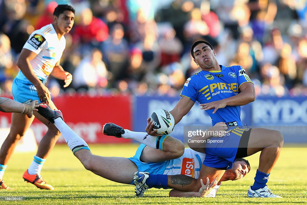 Ken Sio of the Eels is tackled during the round 11 NRL match between the Parramatta Eels and the Gold Coast Titans at Glen Willow Regional Sports Stadium on May 26, 2013 in Mudgee, Australia.