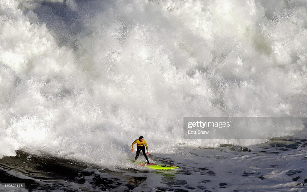 Ken 'Skindog' Collins competes during the first heat of Mavericks Invitational surf competition on January 20, 2013 in Half Moon Bay, California.