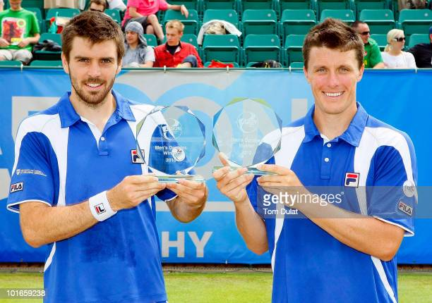 Ken Skupski and Colin Fleming of Great Britain pose with Aegon Trophy after winning the men's doubles final match between Ken Skupski and Colin...