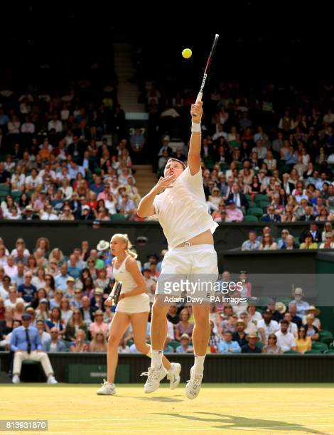 Ken Skupski in action during his doubles match with Jocelyn Rae on day ten of the Wimbledon Championships at The All England Lawn Tennis and Croquet...