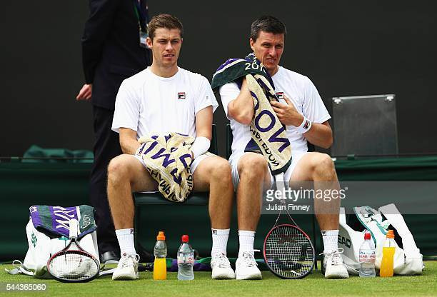 Ken Skupski of Great Britain and his partner of Neal Skupski of Great Britain look on during the Men's Singles first round match against Oliver...