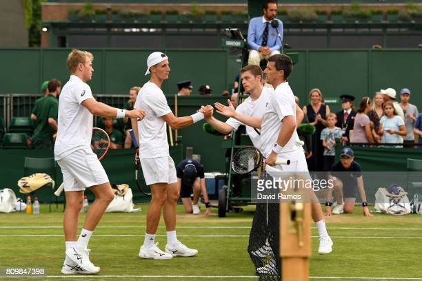 Ken Skupski of Great Britain and Neal Skupski of Great Britain and Brydan Klein of Great Britain and Joe Salisbury of Great Britain shake hands after...