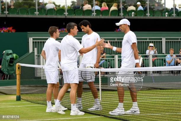 Ken Skupski of Great Britain and Neal Skupski of Great Britain and Lukasz Kubot of Poland and Marcelo Melo of Brazil shake hands after the...