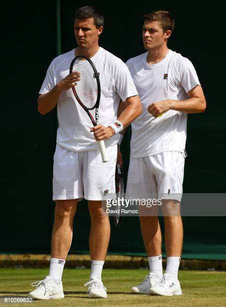 Ken Skupski of Great Britain and Neal Skupski of Great Britain in discussion during the Gentlemen's Doubles second round match against Rohan Bopanna...