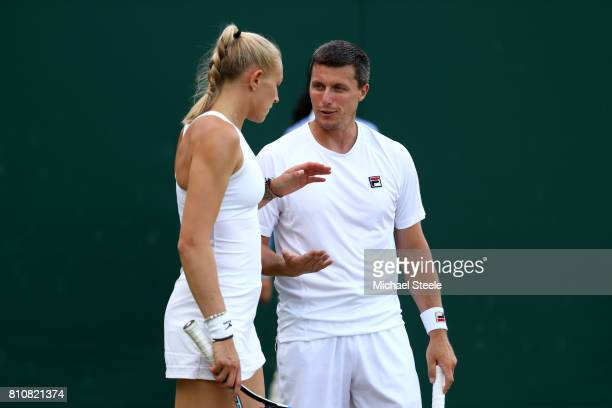 Ken Skupski of Great Britain and with Jocelyn Rae of Great Britain speak during the Mixed Doubles first round match against Edouard RogerVasselin of...