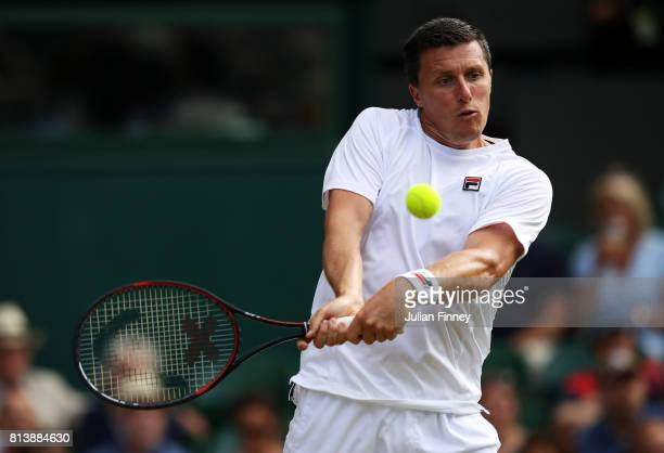 Ken Skupski of Great Britain plays a backhand during the Mixed Doubles quarter final match against Jamie Murray of Great Britain and Martina Hingis...