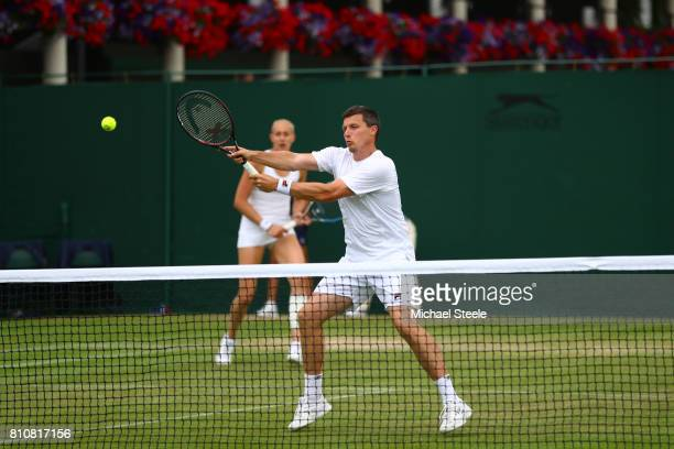 Ken Skupski of Great Britain plays a forehand during the Mixed Doubles first round match with Jocelyn Rae of Great Britain against Edouard...