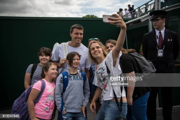 Ken Skupski poses for a selfie with fans on day nine of the Wimbledon Lawn Tennis Championships at the All England Lawn Tennis and Croquet Club on...