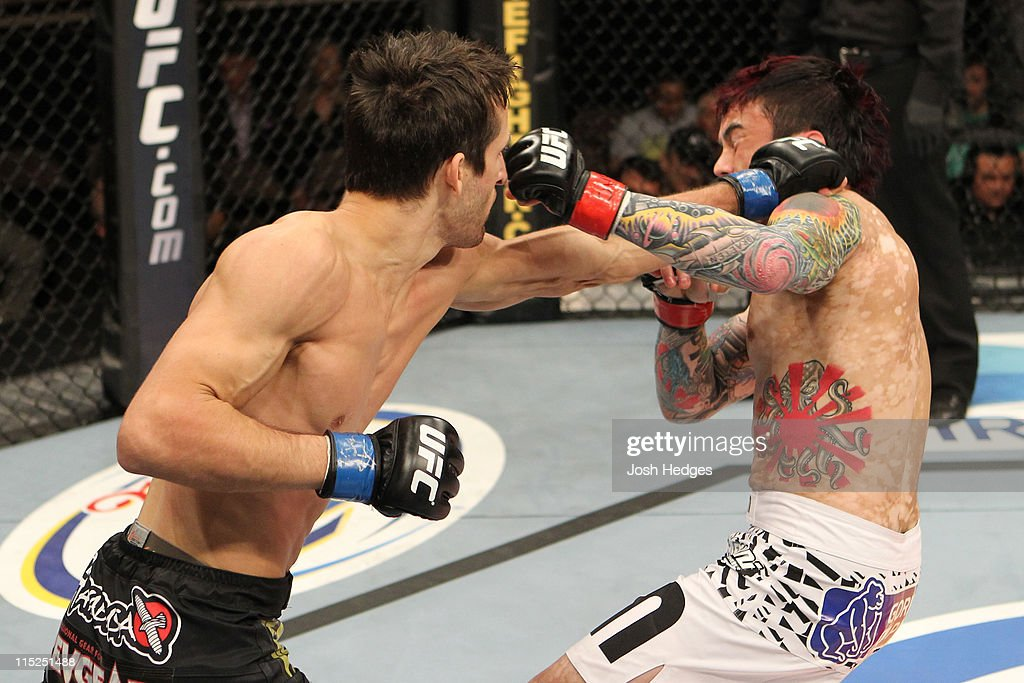Ken Stone punches Scott Jorgensen during their bantamweight fight at the Ultimate Fighter Season 13 Finale at the Pearl at the Palms on June 4, 2011 in Las Vegas, Nevada.