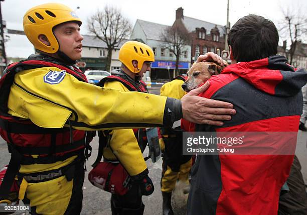Ken Sugden and his rescued dog Kerry are reunited by an Inspector from the RSPCA rescue team in the centre of Cockermouth on November 21 2009 in...