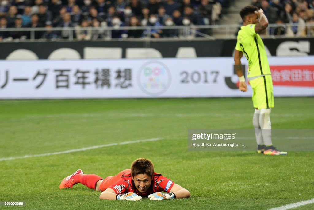 Ken Tajiri of Gamba Osaka shows dejection after Rafael Silva of Urawa Red Diamonds scores his side's first goal during the J.League J1 match between Gamba Osaka and Urawa Red Diamonds at Suita City Football Stadium on March 19, 2017 in Suita, Osaka, Japan.