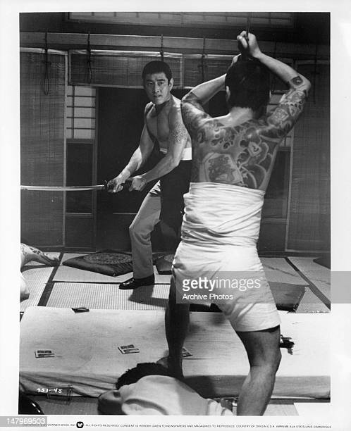 Ken Takakura in sword fight in a scene from the film 'The Yakuza' 1974