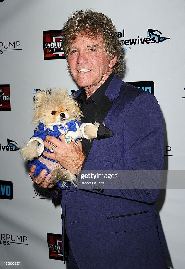 Ken Todd and dog Giggy The Pom attend the 'The Real Housewives of Beverly Hills' and 'Vanderpump Rules' premiere party at Boulevard3 on October 23, 2013 in Hollywood, California.