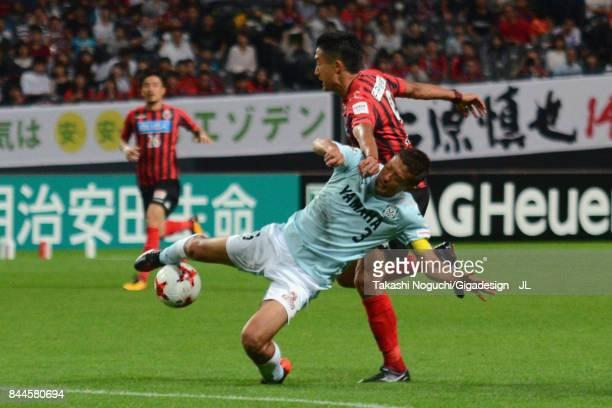 Ken Tokura of Consadole Sapporo and Kentaro Oi of Jubilo Iwata compete for the ball during the JLeague J1 match between Consadole Sapporo and Jubilo...