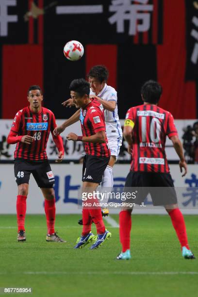 Ken Tokura of Consadole Sapporo and Kento Misao of Kashima Antlers compete for the ball during the JLeague J1 match between Consadole Sapporo and...