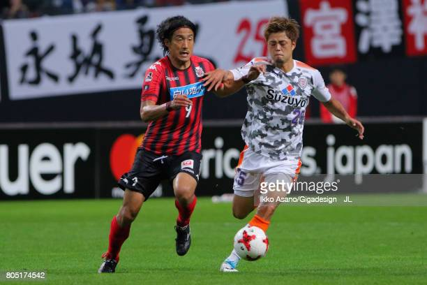 Ken Tokura of Consadole Sapporo and Ko Matsubara of Shimizu SPulse compete for the ball during the JLeague J1 match between Consadole Sapporo and...