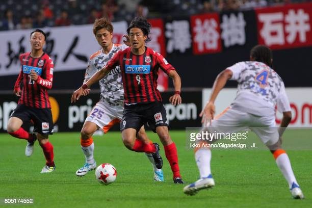 Ken Tokura of Consadole Sapporo and Ko Matsubara of Shimizu SPulse compete for the ball during the JLeague J1 match between Consadole Sapporo and...
