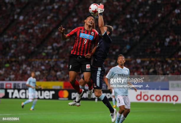 Ken Tokura of Consadole Sapporo and Krzysztof Kaminski of Jubilo Iwata compete for the ball during the JLeague J1 match between Consadole Sapporo and...