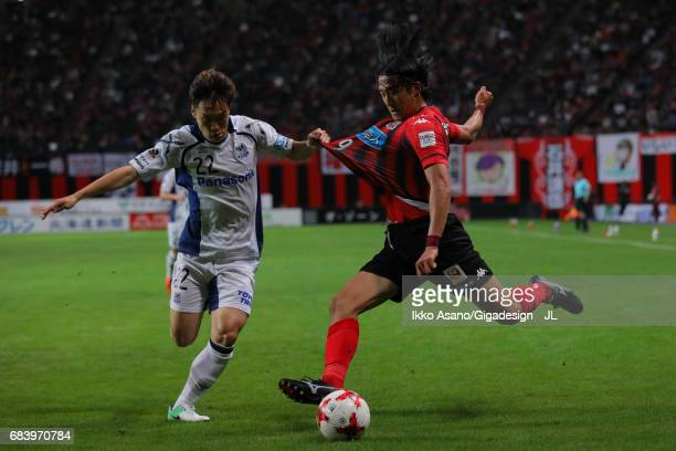 Ken Tokura of Consadole Sapporo and Oh Jae Suk of Gamba Osaka compete for the ball during the JLeague J1 match between Consadole Sapporo and Gamba...